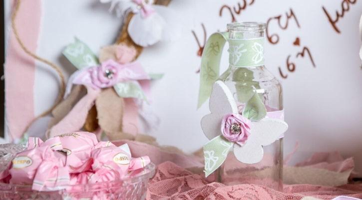 Μπομπονιέρες βάπτισης με γυάλινο μπουκαλάκι και πεταλούδα